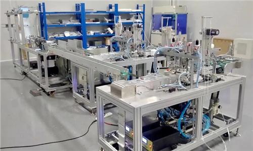 单机可日产口罩12万 通用技术集团首台平面口罩机机电联调一次成功